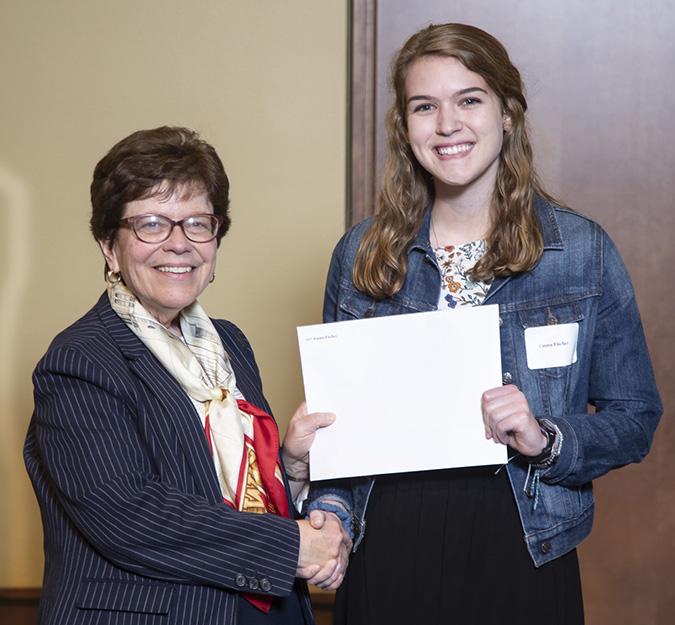 Emma receiving the Sophomore Fellowship with Chancellor Blank